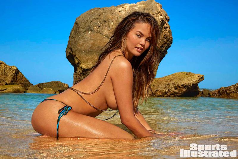 Chrissy Teigen topless in the sea