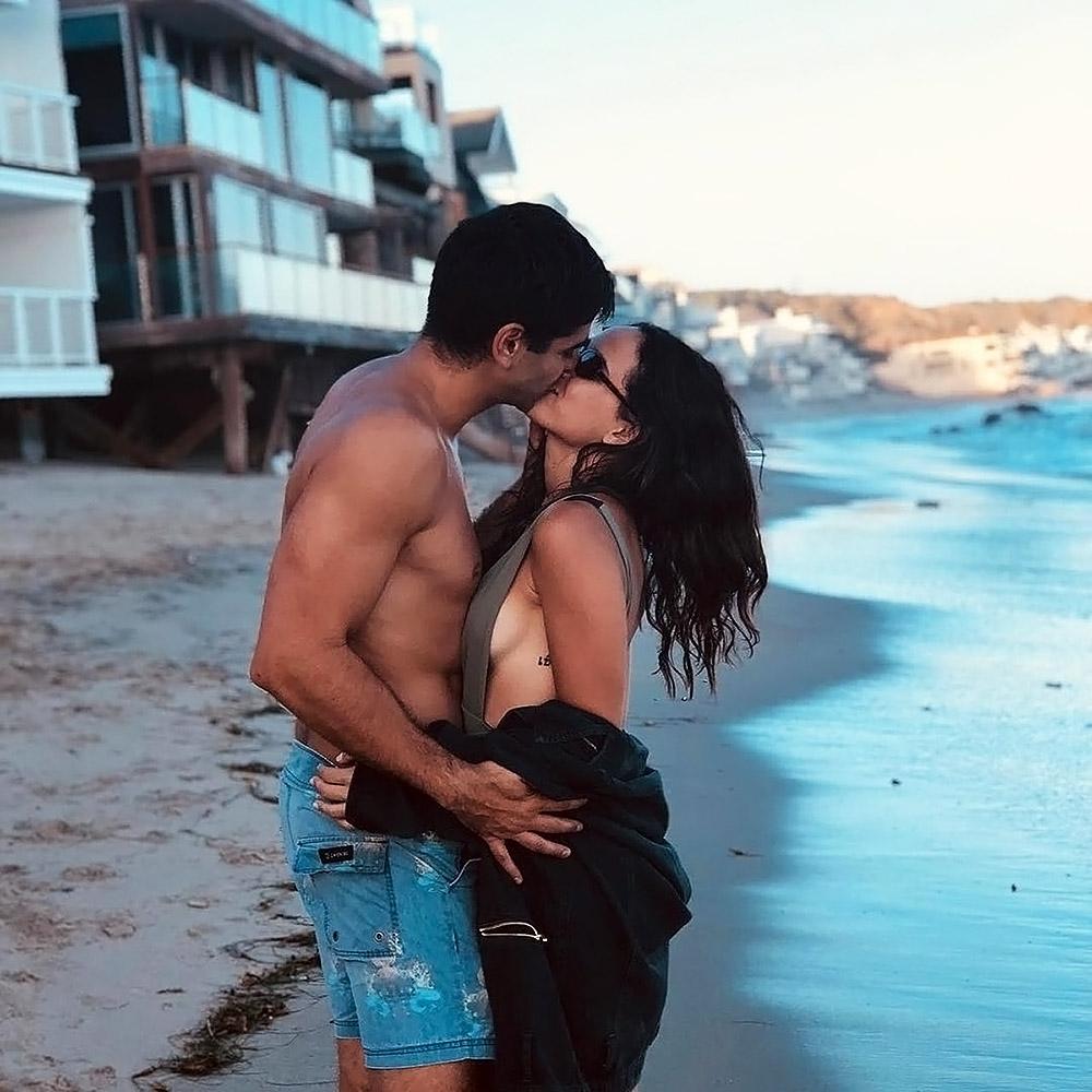 Adria Arjona kissing a boyfriend