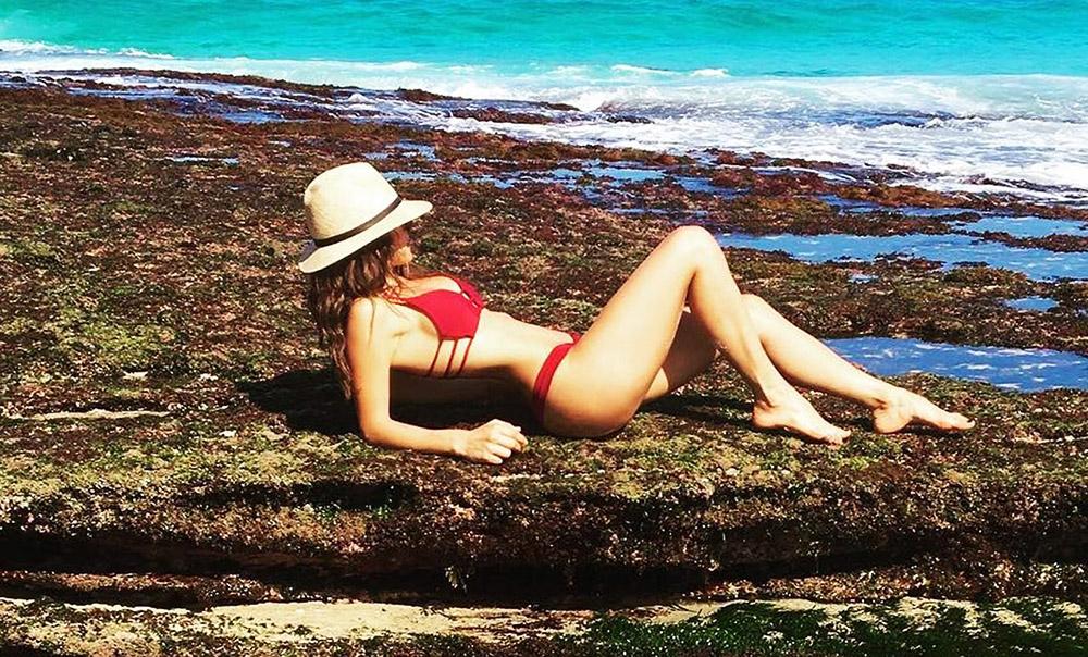 Adria Arjona lying in bikini