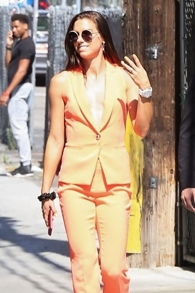 Alex Morgan sexy orange suit
