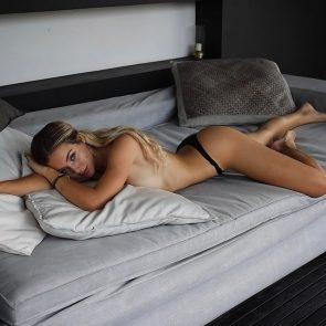 Charly Jordan topless on bed