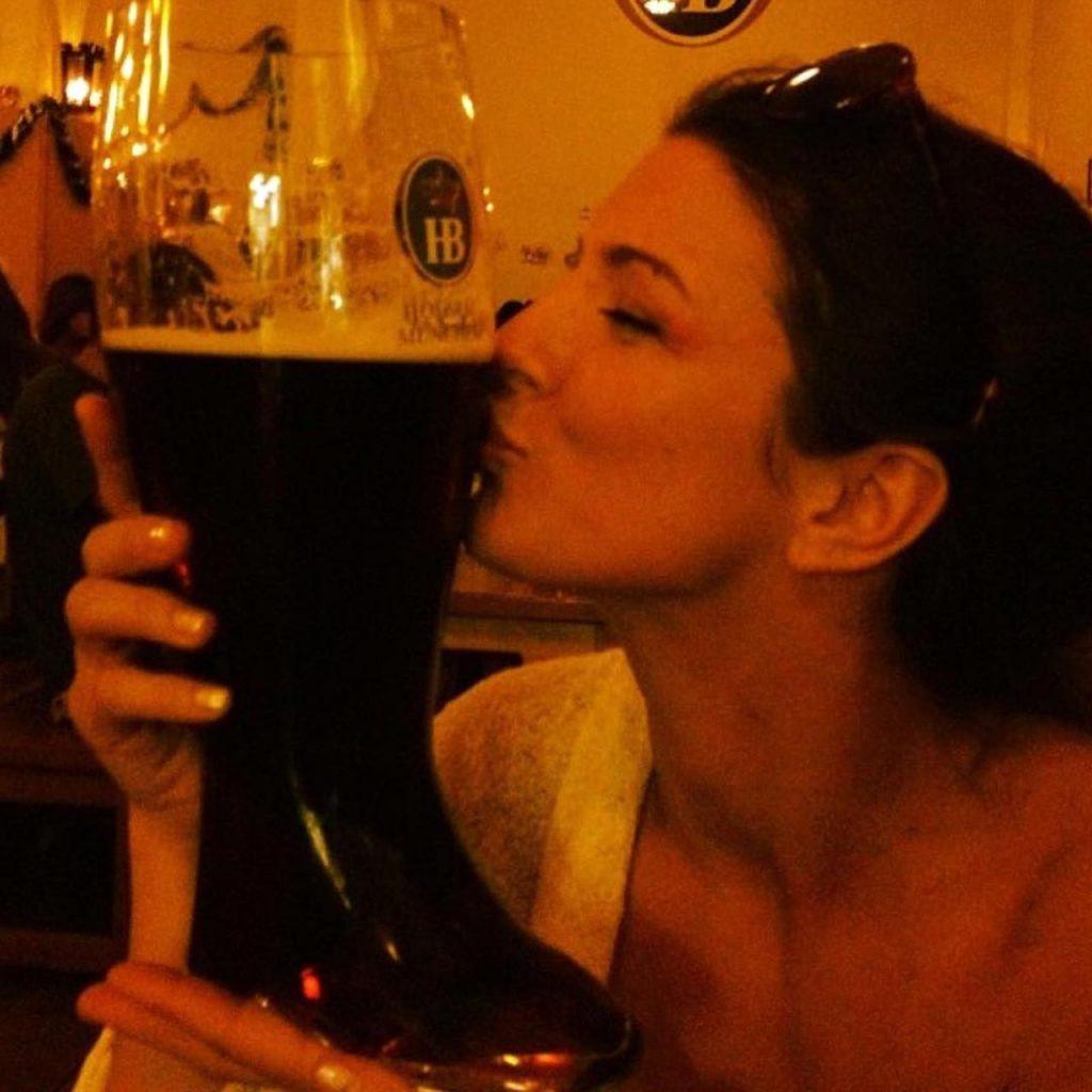 Gina Carano kissing beer