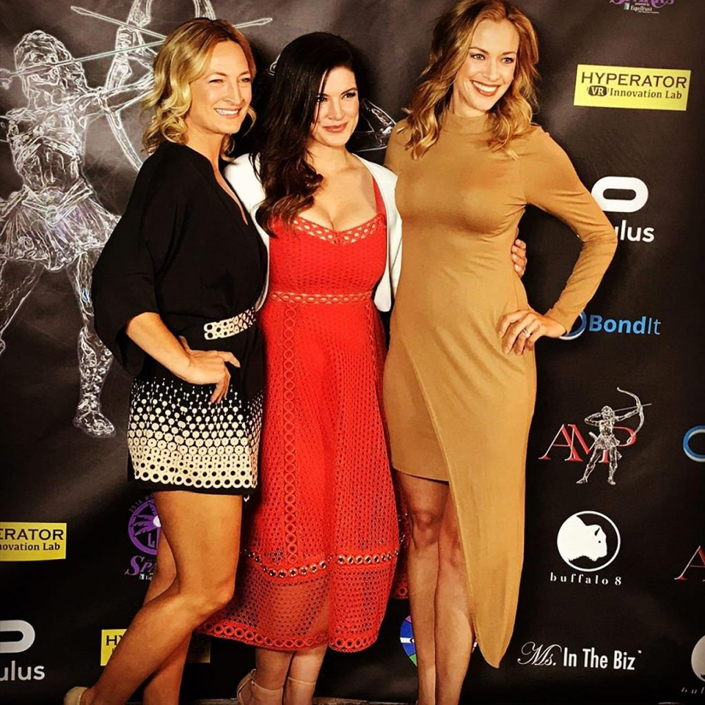 Gina Carano in red dress