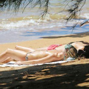 Margot Robbie topless sunbathing