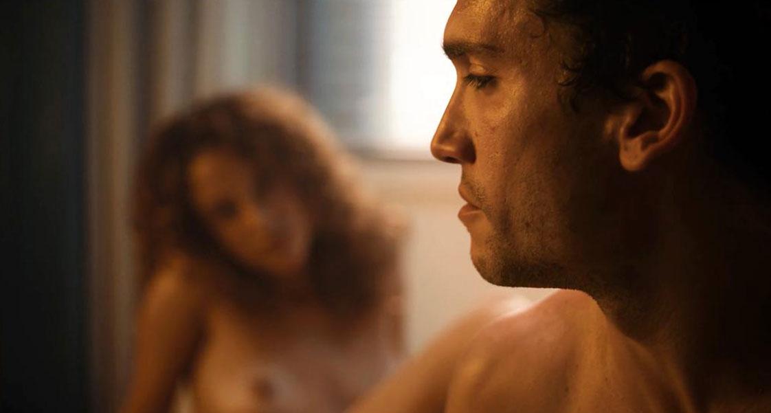 Maria Pedraza nude behind a guy